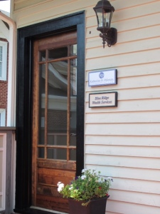 The entrance to our office is located on the back of the building.